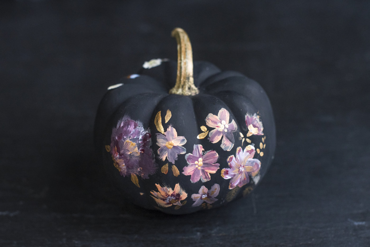 This year try decorating your pumpkins with dried flowers Flower painted pumpkins
